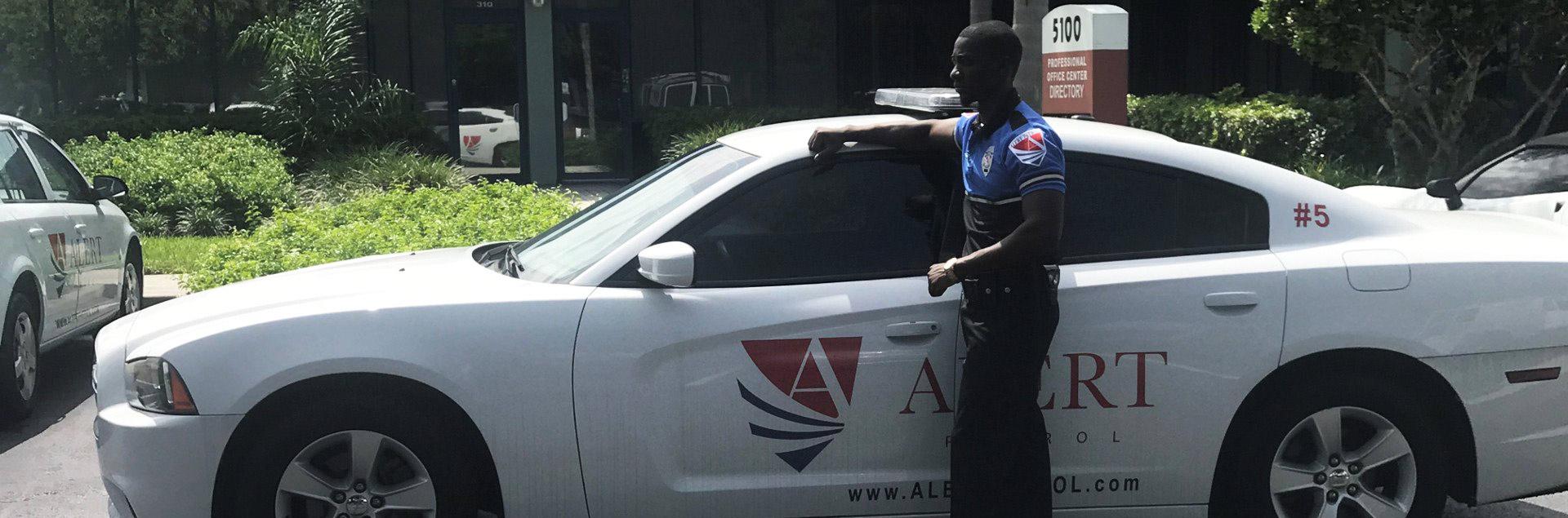 security guard next to a car